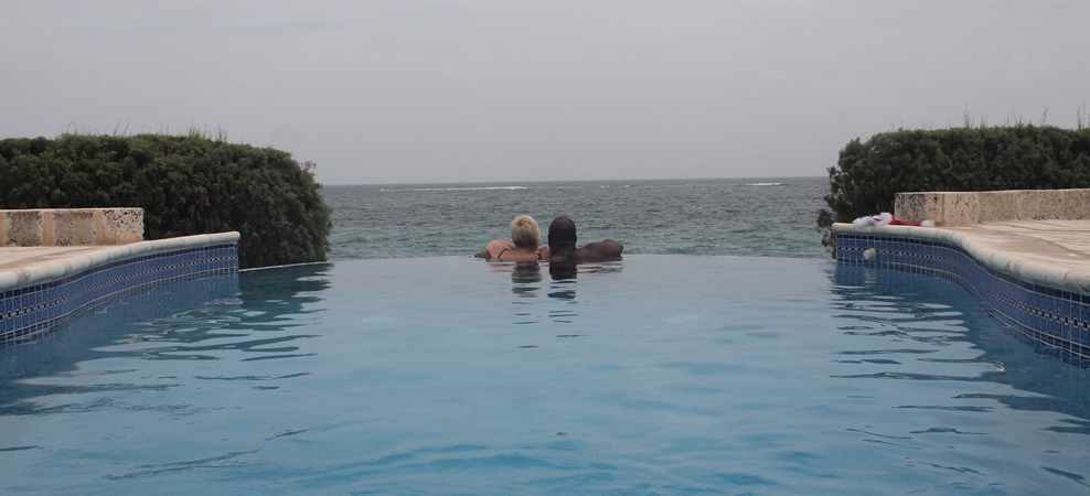 photo of couple looking out to sea in the infinity pool - next land in site is africa