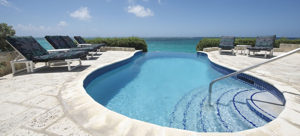 photo of wavecrest infinity pool and patio during the day